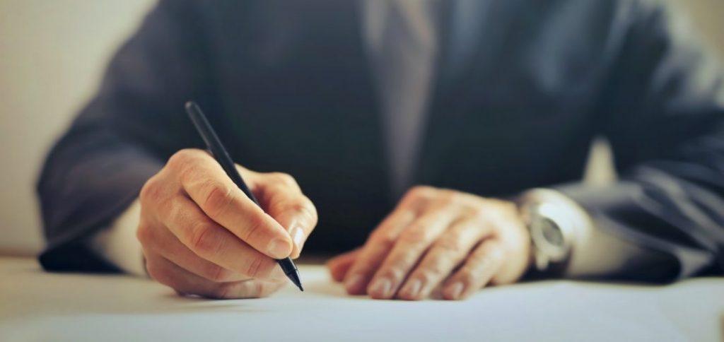 man signing contract malaysian cv