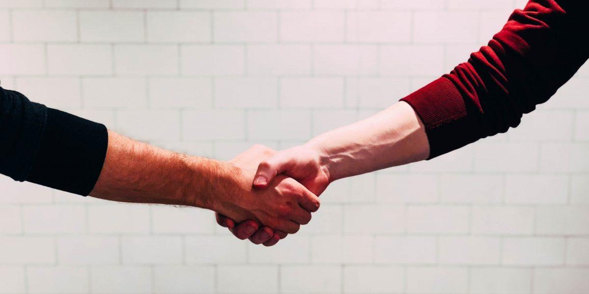 job interview company featured image handshake