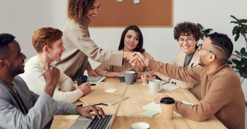 international team benefits handshake in meeting