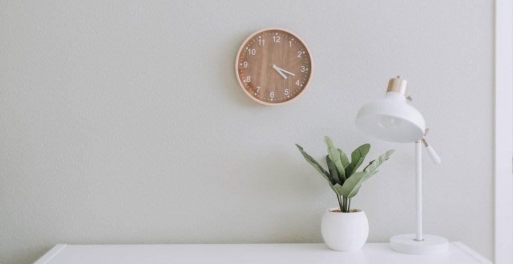 white wall clock woman job interview